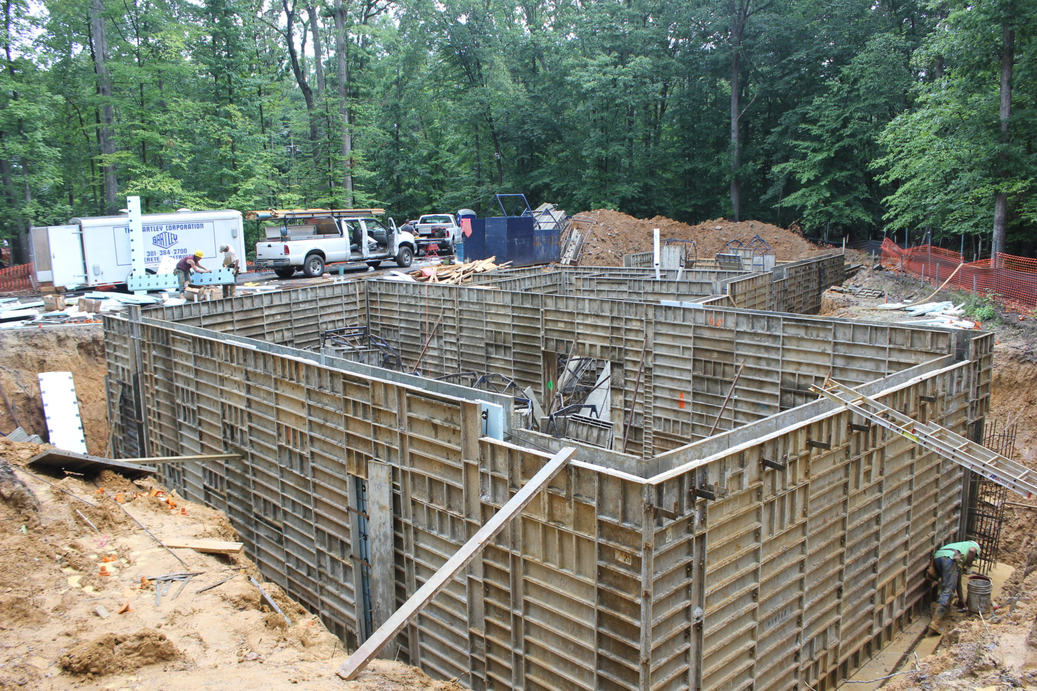 Insulation for concrete walls are centered and placed for Poured wall foundation