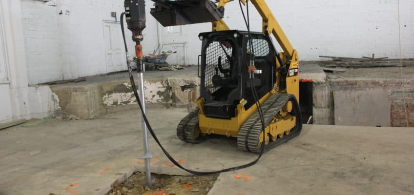 Helical Pier Skid Loader Attachment